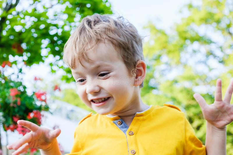 Child happy boy is smiling enjoying life. Portrait of boy in nature, park or outdoors. Concept of happy family stock photos