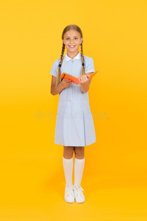 Child happy girl hold book enjoy studying. School library concept. Knowledge source. Informal education concept. Join. Literature club. School education stock images
