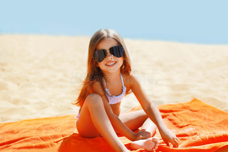 Child has a rest summer. Child has a rest in the summer on the beach royalty free stock image