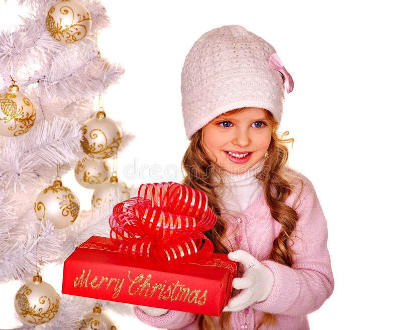 Child in hat and mittens holding Christmas red royalty free stock photography