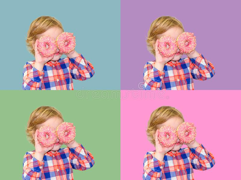 Child is having fun with donut. Tasty food for playing kids. royalty free stock photography