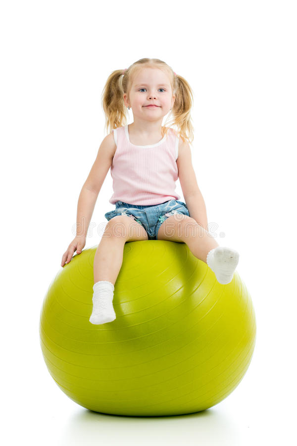 Child having fun with gymnastic ball isolated royalty free stock images