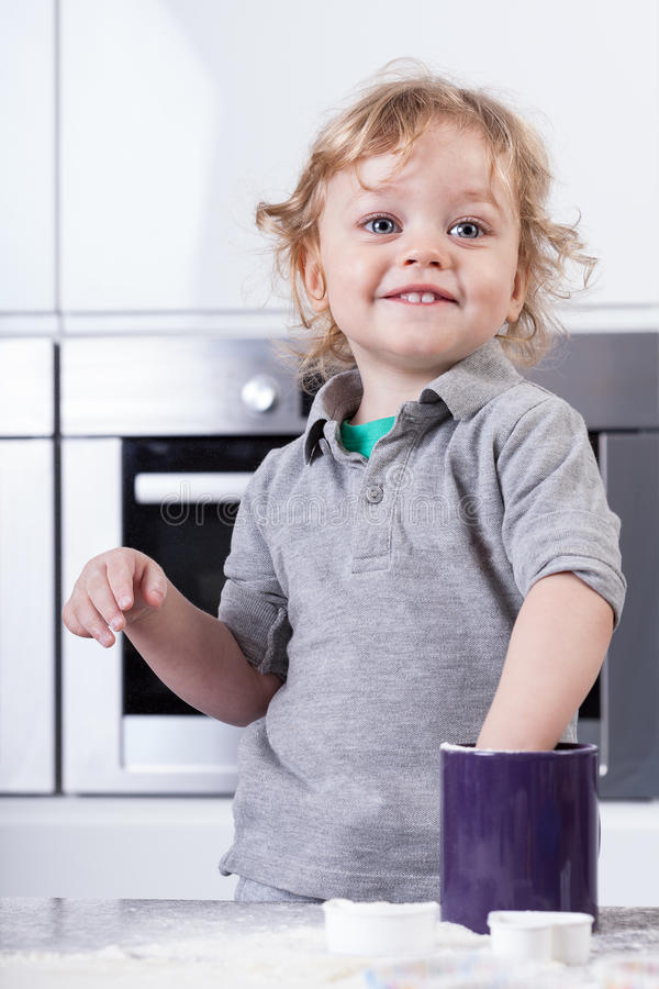 Child having good time in kitchen stock image