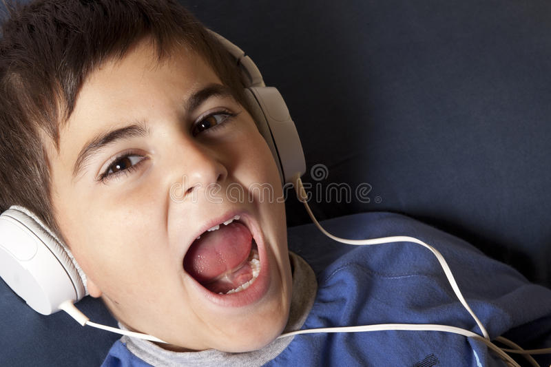 Child with headphone. Caucasian child shouting with headphone stock images