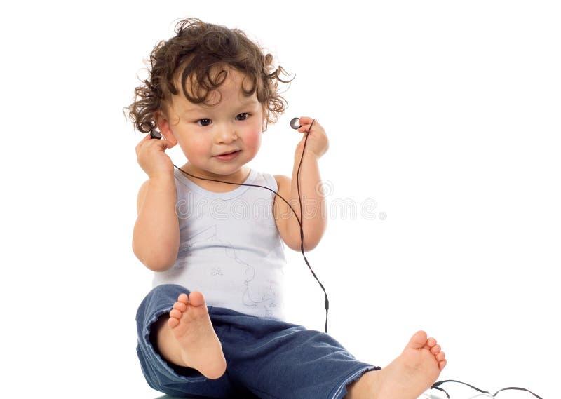 Child with headphones. stock photo