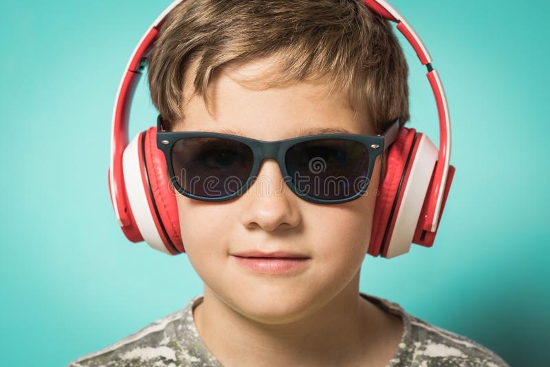 Child with headphones of music and funny expression royalty free stock photography