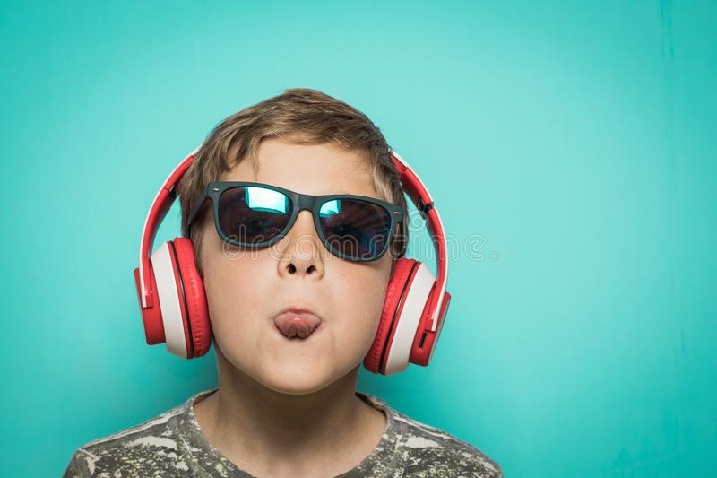 Child with headphones of music and funny expression royalty free stock photo