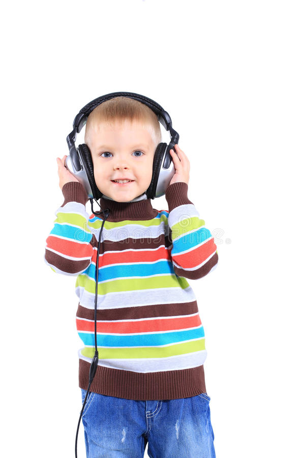 Child in headphones, white background stock photography