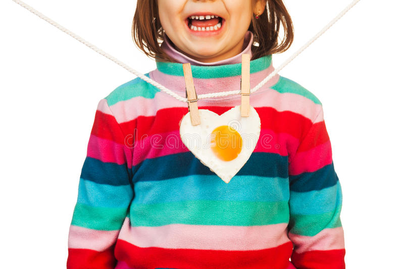 Child with heart shaped egg royalty free stock image