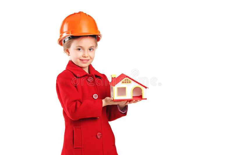 A child with helmet holding a model house royalty free stock images