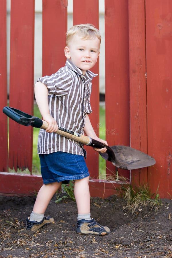 Child helping shovel stock photos