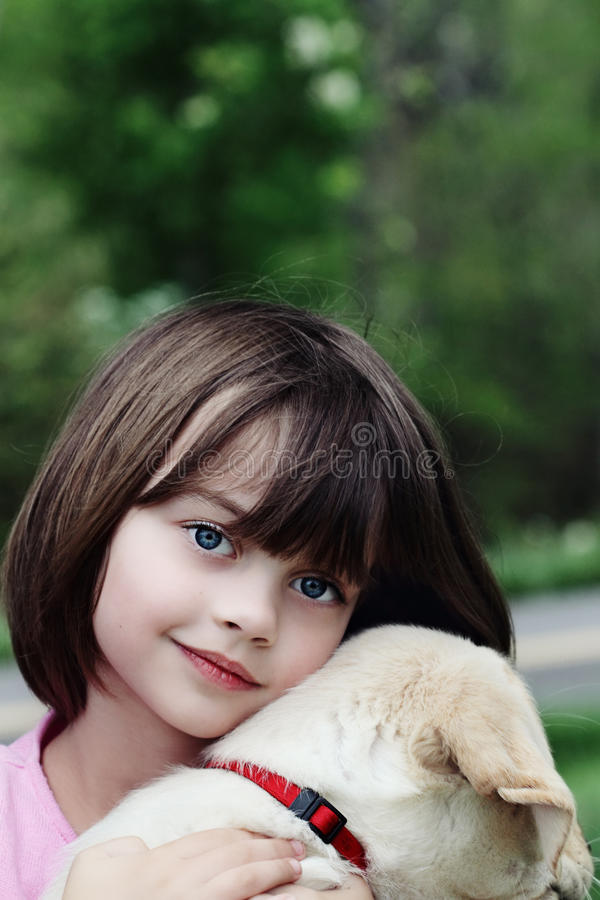 Child and Her Puppy stock photo