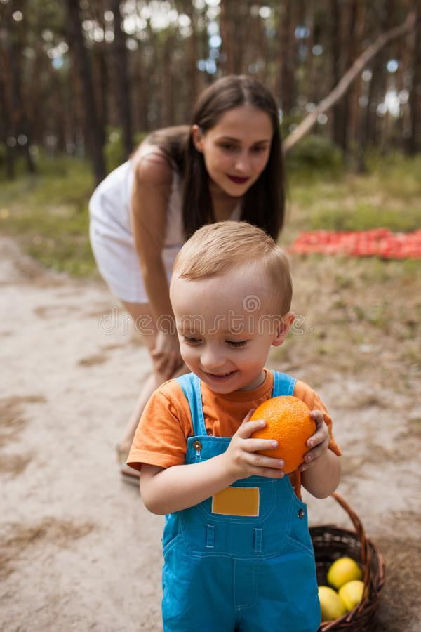 Child hide orange family picnic concept. royalty free stock image