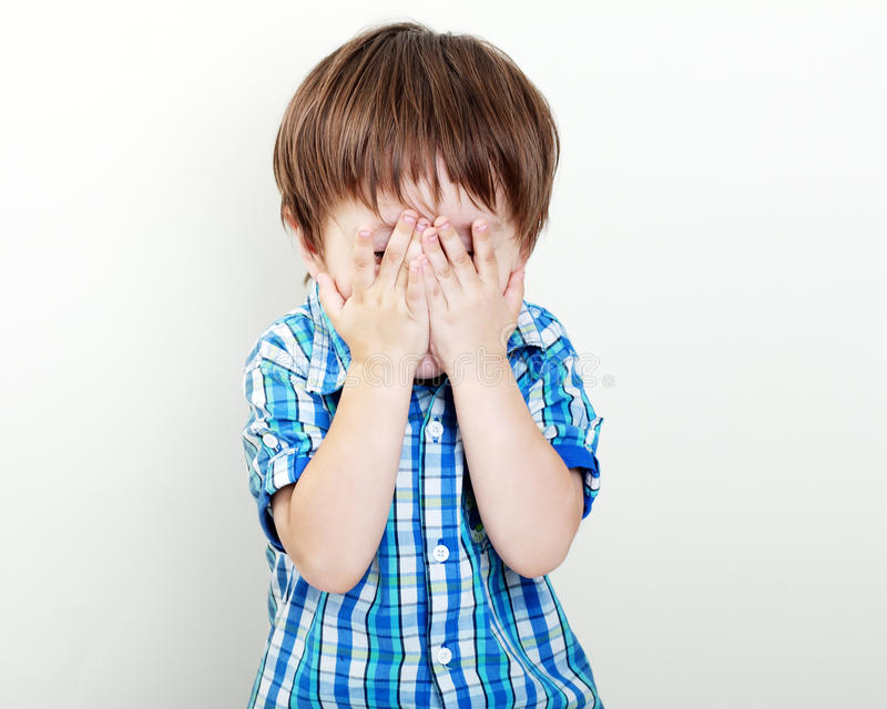 Child hiding royalty free stock photography
