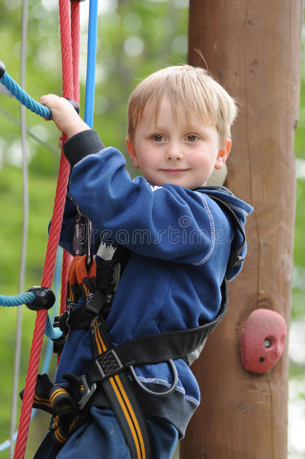 Child on high rope royalty free stock photos