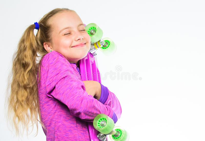 Child hold penny board. Choose skateboard that looks great and also rides great. Penny board of her dream. Best gift for royalty free stock photos