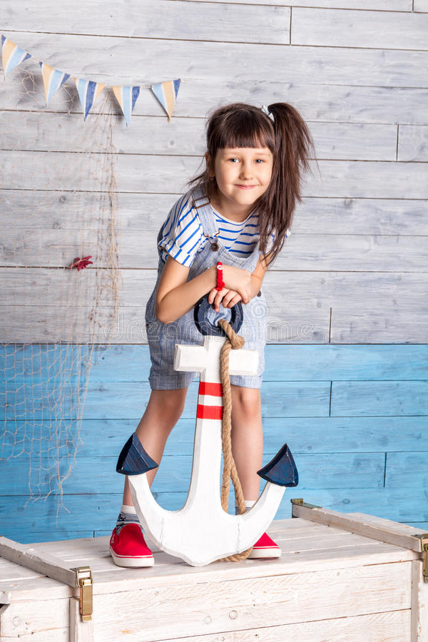 Child holding anchor stock photo