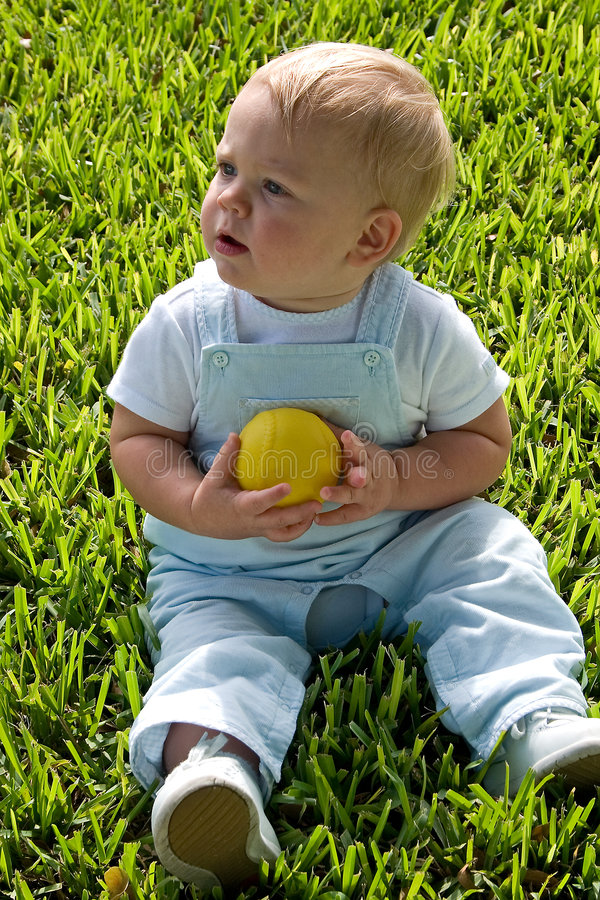 Child Holding Ball Royalty Free Stock Photography