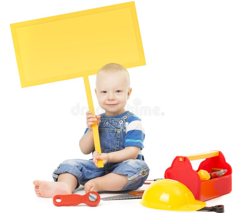 Child holding Banner Sign, Baby Boy Playing Toys Tools, White royalty free stock photos