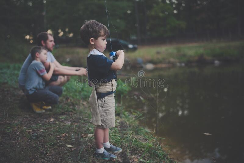 Child Holding Blue And Black Fishing Rod Beside Body Of Water Free Public Domain Cc0 Image