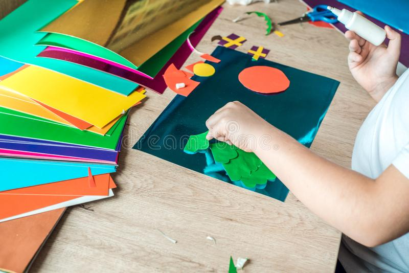 Child is holding a Christmas ball decor in his hands. Child is showing a Christmas ball decor. Simple recycled crafts and activiti. Es for kids. Christmas decor stock images