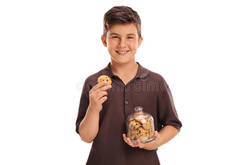 Child holding a cookie and a jar royalty free stock photos