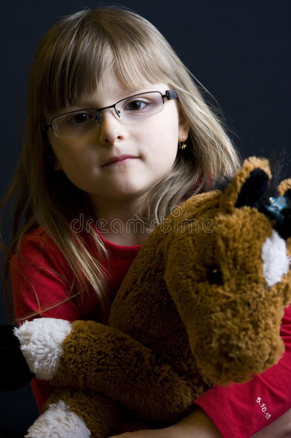 Download Child holding cuddly toy stock image. Image of child, single - 9485133