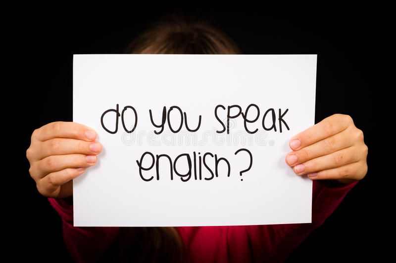 Child holding Do You Speak English sign stock photos