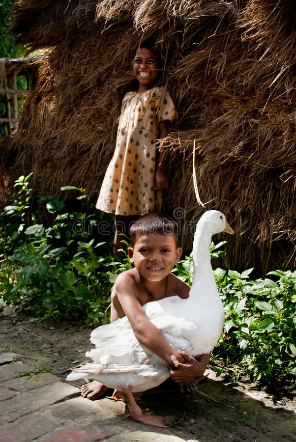 Child holding a duck royalty free stock image