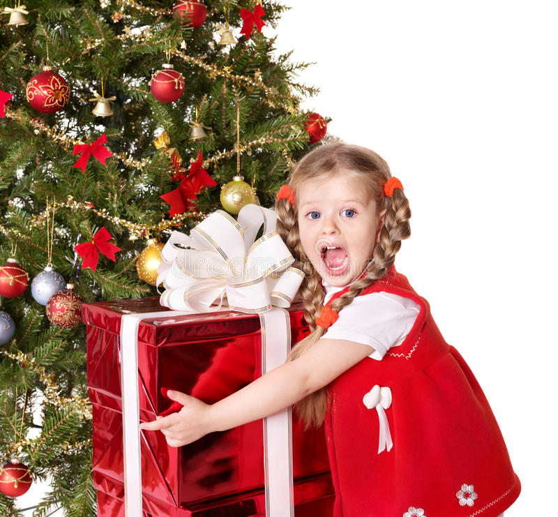 Download Child Holding Gift Box By Christmas Tree. Royalty Free Stock Image - Image: 16995286