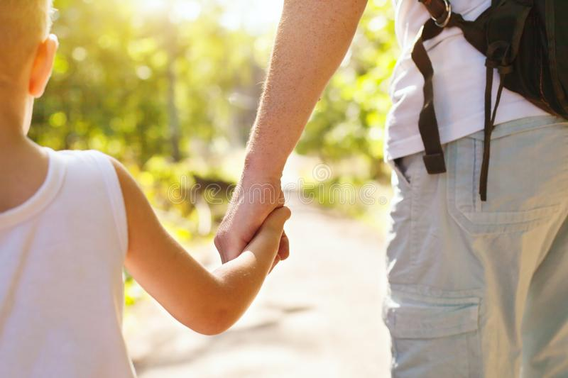 Father and child holding hands stock photography