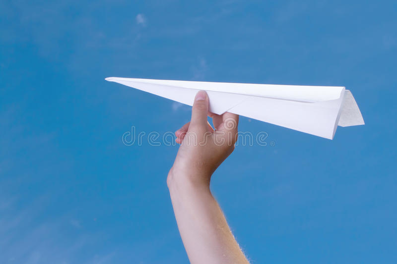 Download Child Holding A Paper Airplane Stock Image - Image: 25677745