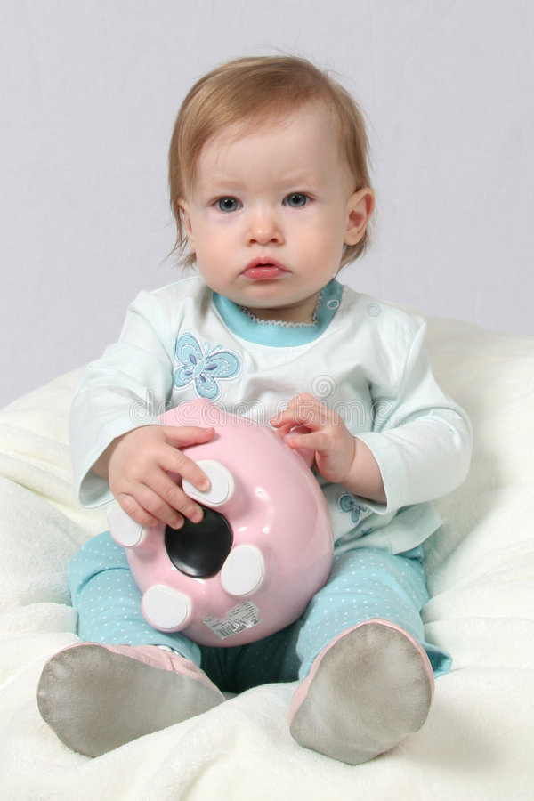 Download Child Holding Piggy Bank stock photo. Image of baby, money - 2300542