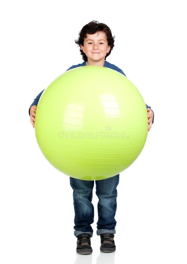 Child holding a pilates ball royalty free stock photos