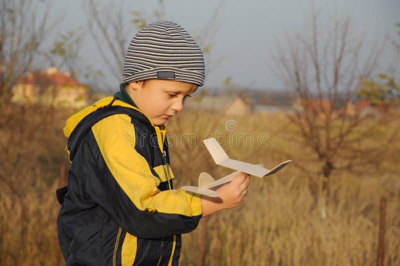 Child holding plane model stock images