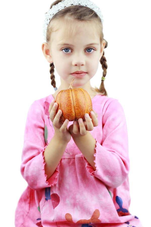 Child Holding Pumpkin royalty free stock images
