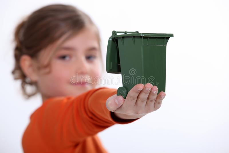 Child holding recycling bin royalty free stock photography