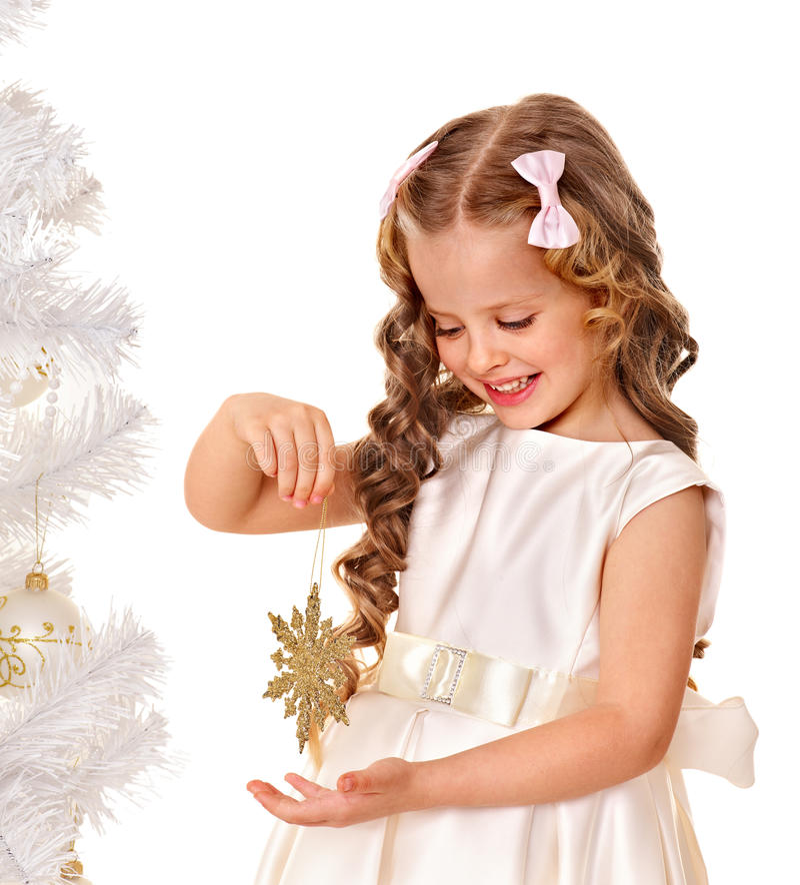 Child holding snowflake to decorate Christmas tree . royalty free stock photos