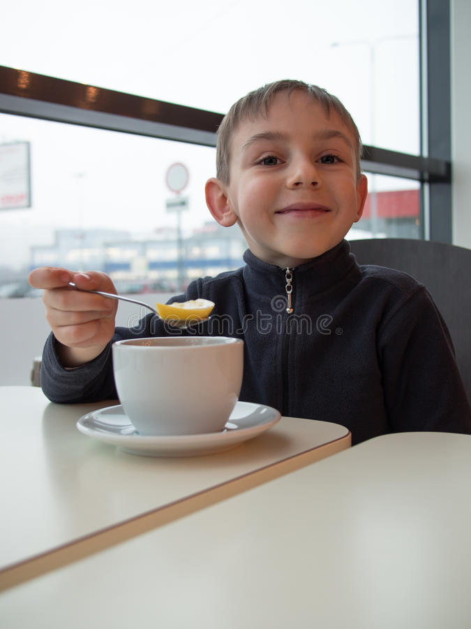 Child holding a spoon with lemon stock images