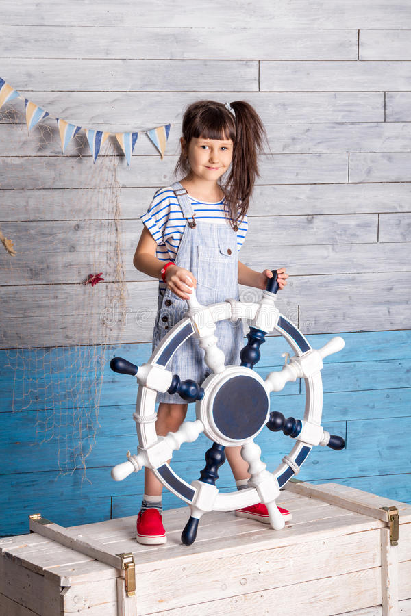 Child holding a steering wheel royalty free stock photography
