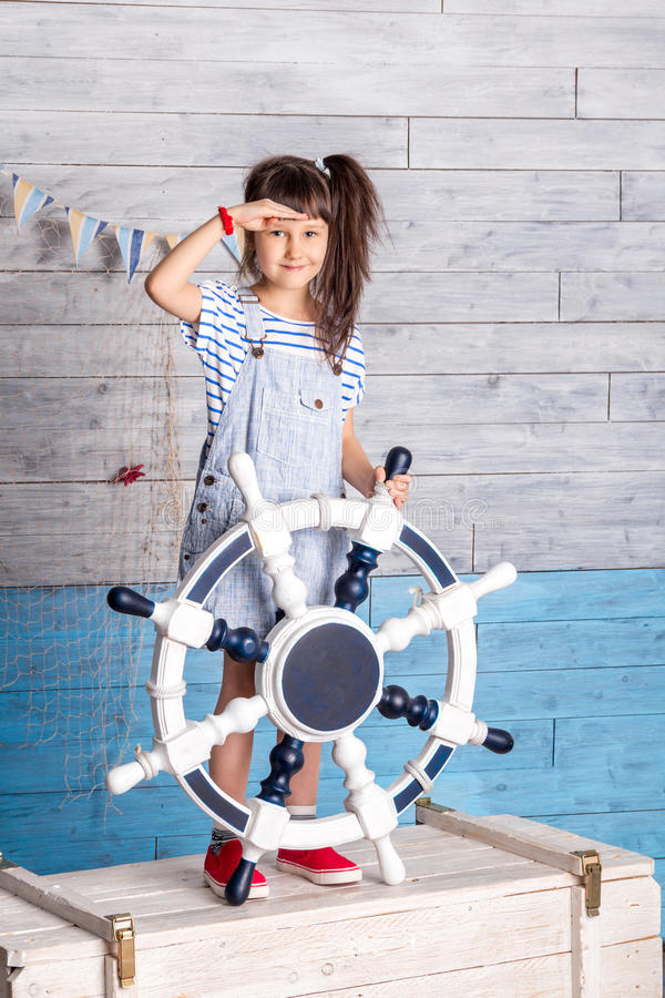 Child holding a steering wheel royalty free stock photos