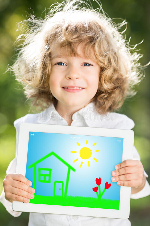 Child holding tablet PC stock photography