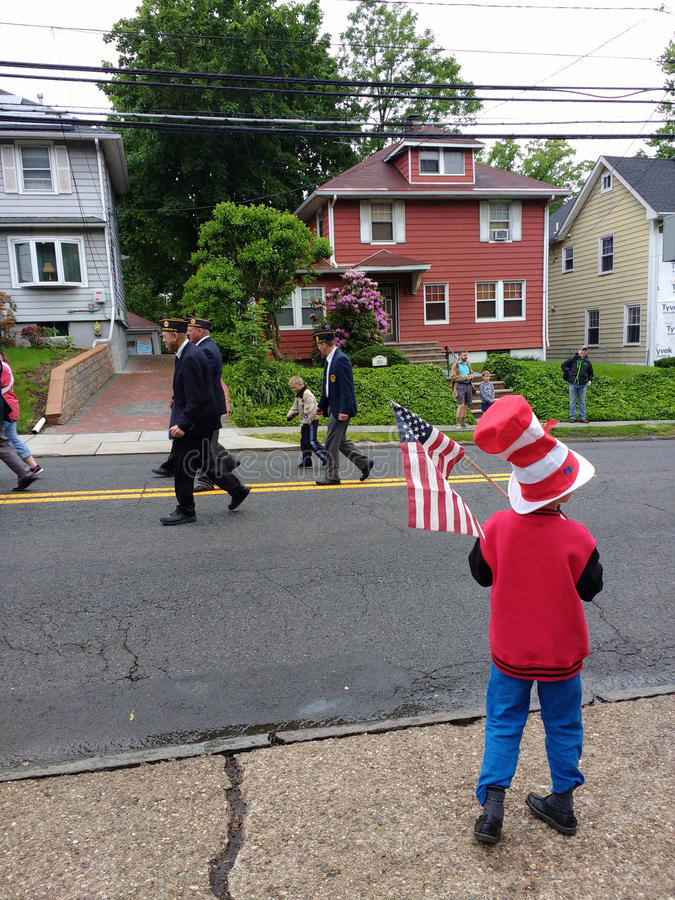Child Holds an American Flag, Memorial Day Parade, USA stock image