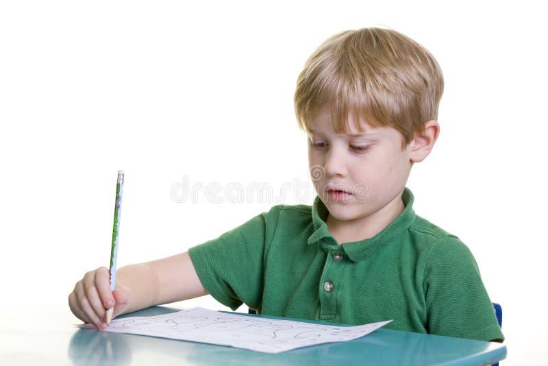 Child with homework stock image
