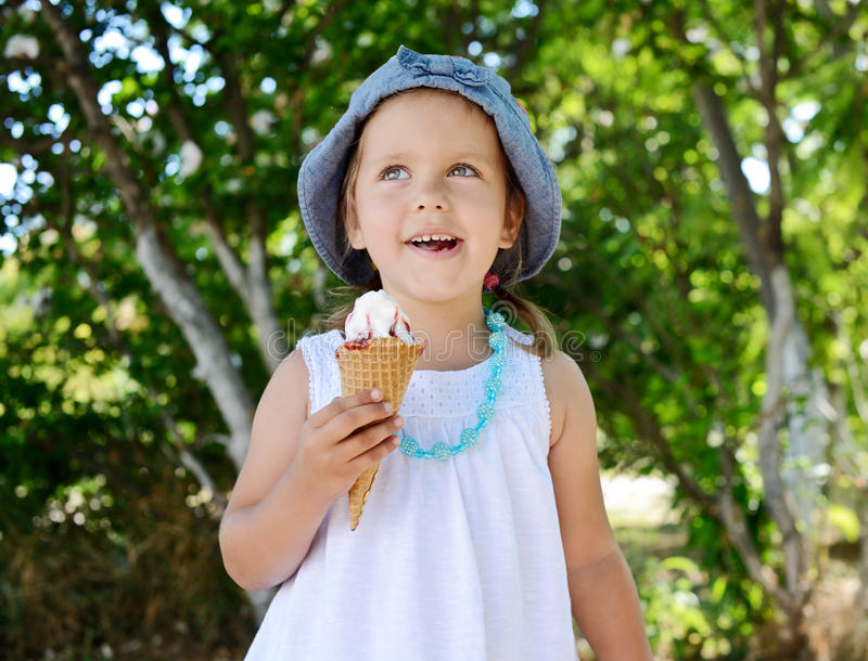 Child with ice cream cone royalty free stock images