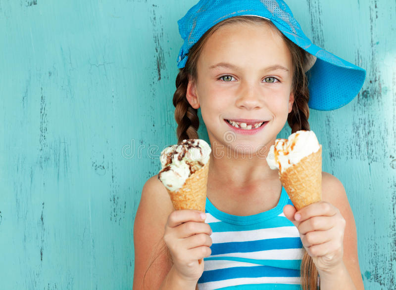 Child with ice cream stock images