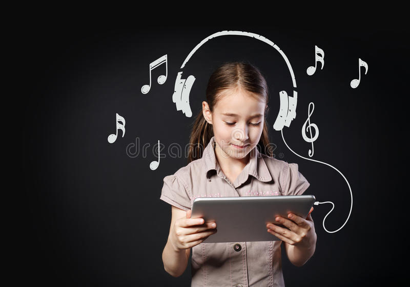 Child and internet music from tablet, imaginary headphones on girl stock images