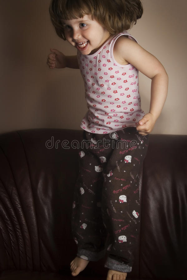 A child jumping stock image