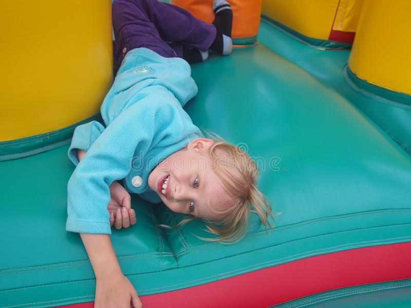 Child jumping in bouncy castle royalty free stock photography