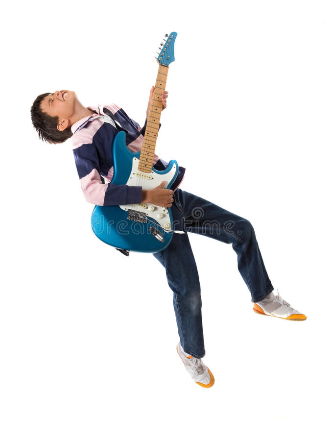 Child jumping with a guitar royalty free stock images